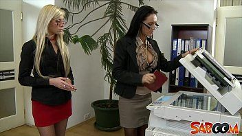 Office lesbian babes go at it